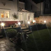 Small LED lamp posts in a garden in Southport - STF Electrical Ltd