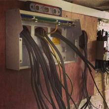 Mounting a new consumer unit / fuseboard ready to terminate the cables - STF Electrical Ltd